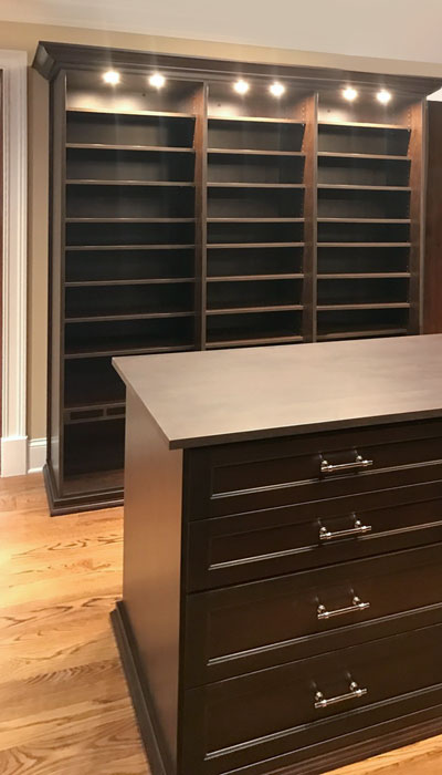 custom master walk in closet with closet islands and shoe shelves