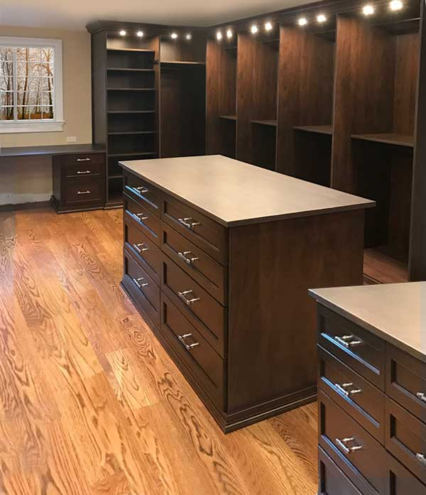 large walk in closet with closet desk under the window