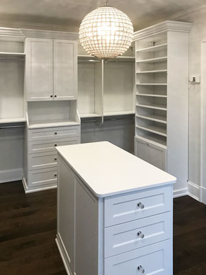 white closet with crystal accents