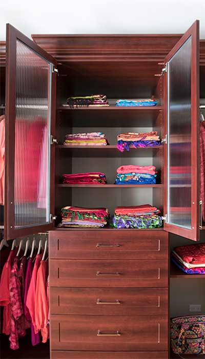 saris stored on shelves
