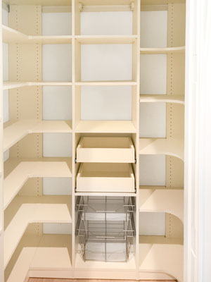 ivory walk-in pantry design with corner shelving