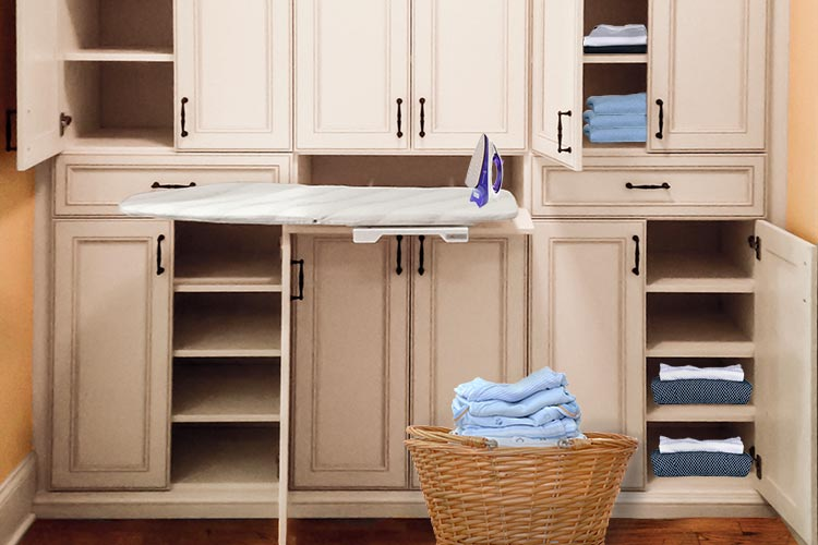 custom laundry room cabinet with storage and pull-out ironing board