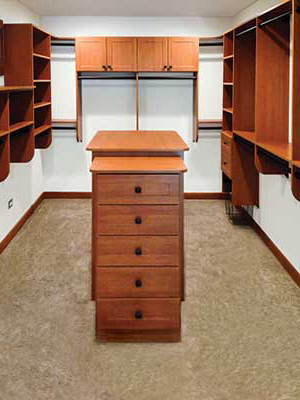 walk-in master closet design with closet island organizer