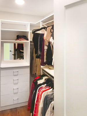 guest closet with framed mirror closet hutch