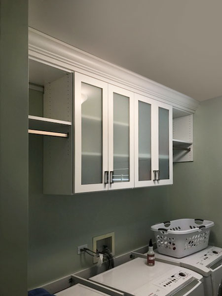 sage colored walls for laundry cabinets