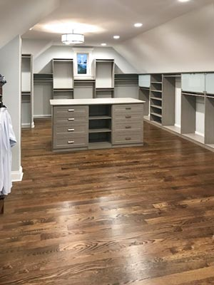 haze laminate master closet design for sloped ceiling room