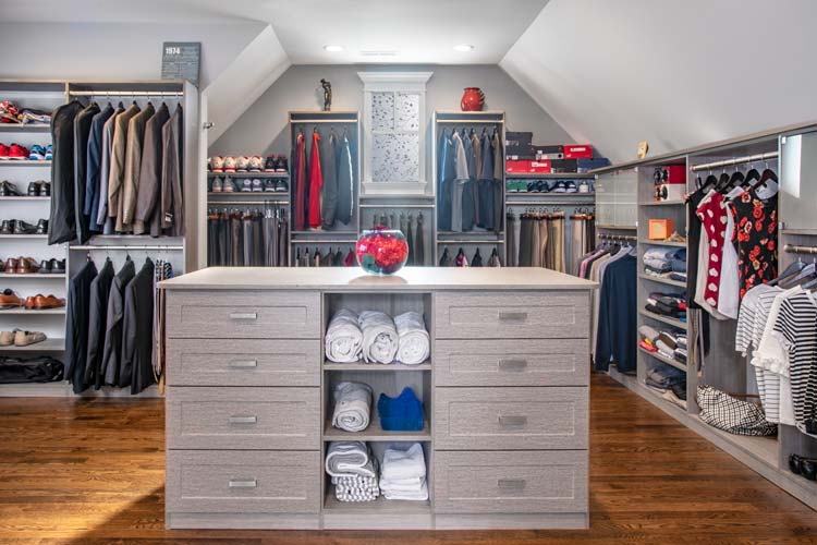 master closet converted from garage attic bonus room with slanted ceiling
