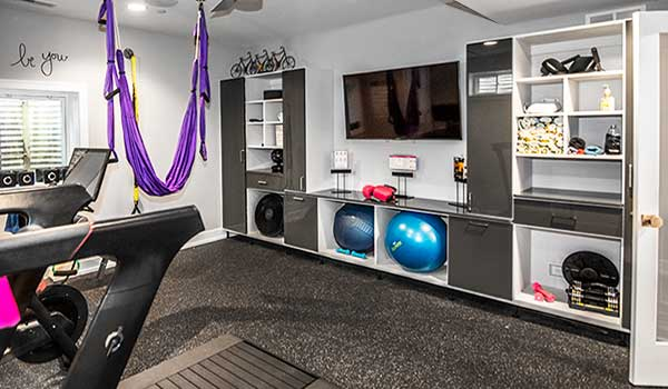 Home gym storage wall unit with TV entertainment center