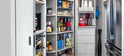 custom small walk-in pantry with rotating corner storage