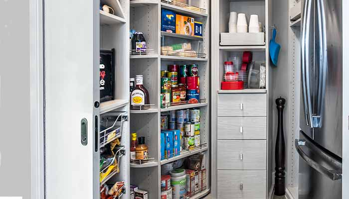 Custom pantry closet with a pocket door