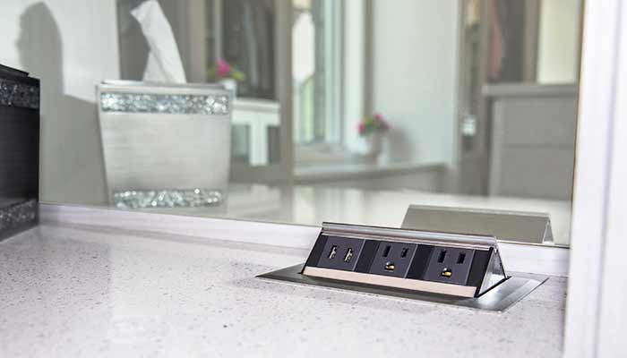 Pop-up phone charging station built into countertop