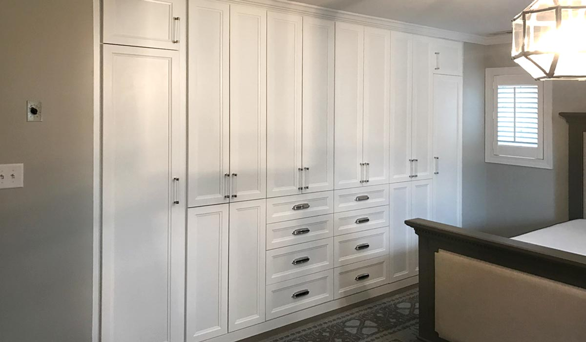 custom built in wardrobe bedroom storage in a transitional wardrobe design