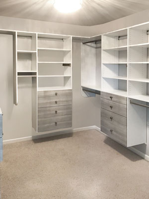 walk in closet with river rock drawer faces