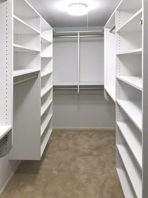 white narrow walk in closet
