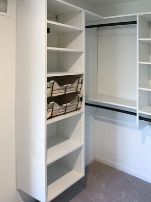 walk in closet with oil rubbed bronze rods and canvas baskets