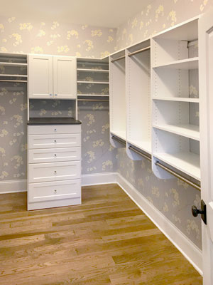 white master walk in closet with closet hutch