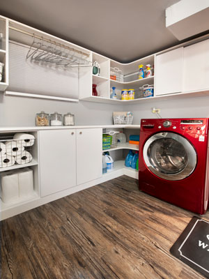 laundry room with curved shelving and sliding doors