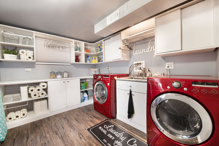 Laundry room with dark red accents in the appliances and accessories