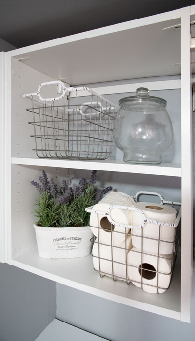 suspended shelving unit for laundry room storage