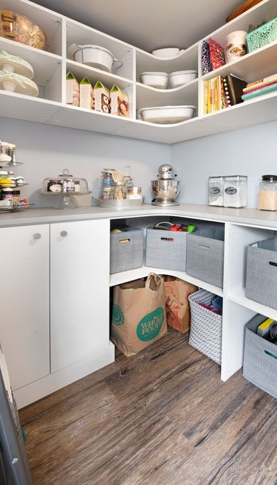 pantry customizations include curved shelving, baskets, and vertical dividers