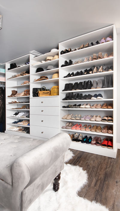 wall of shoe shelves spans the wall