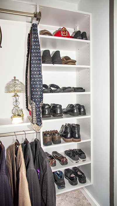 This small closet includes many shelves for storage and organizatione