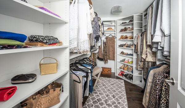 basement remodel to create extra closet with corner closet organizer