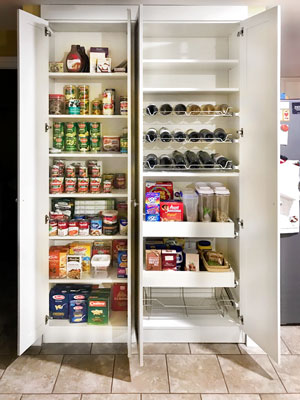pantry closet with pull-out shelves and wine racks