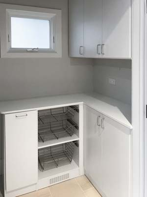 laundry room design with wire baskets