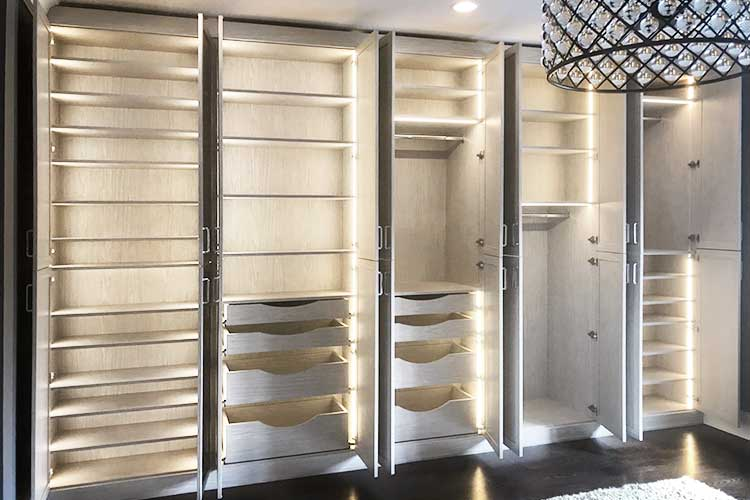 custom built in wardrobe armoire in a transitional design with unique lighting
