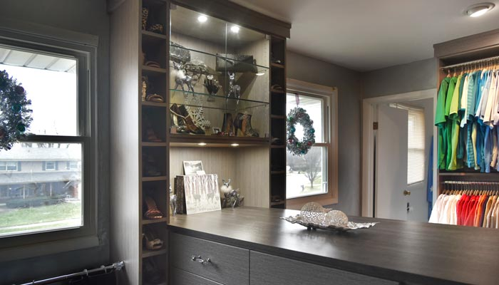 glass cabinets and glass shelving in custom closet island