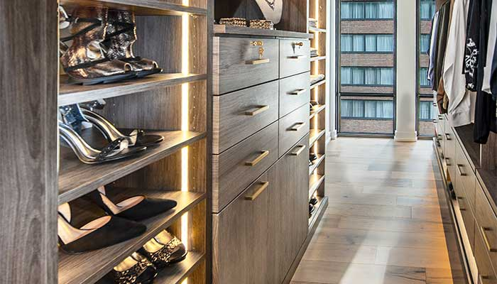 Custom closet with spectacular closet lighting