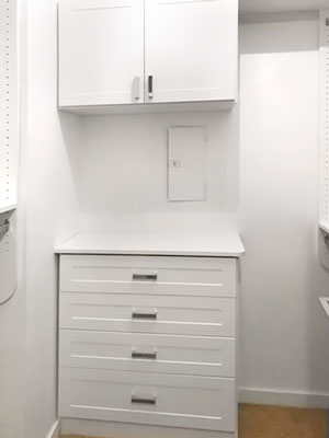 White closet with space for electrical panel