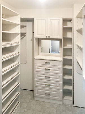 white chocolate closet with shoe shelving