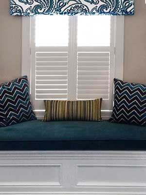 window seat with shutters and shade
