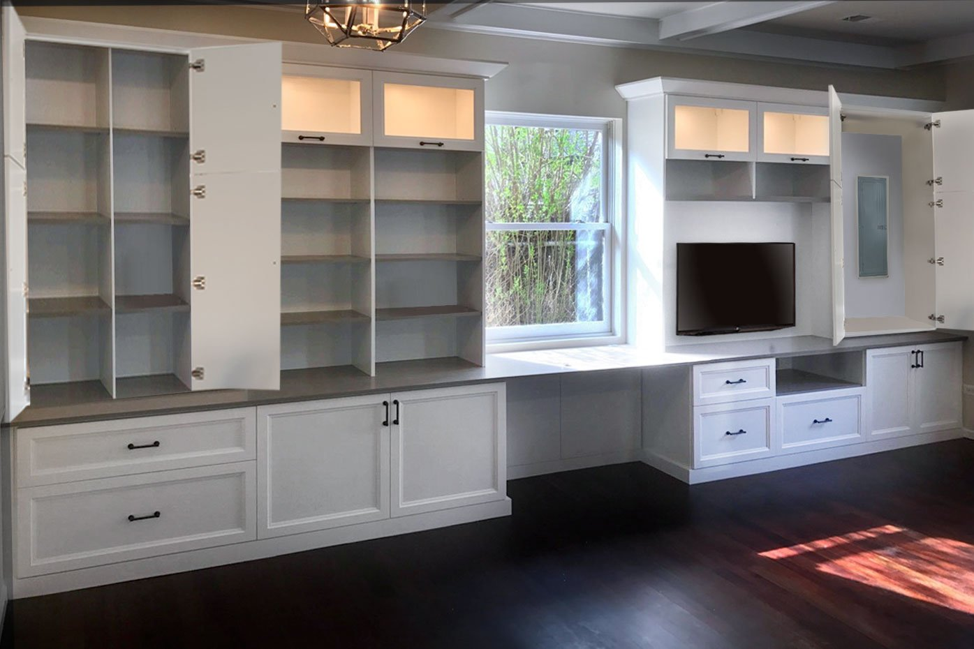wall unit entertainment center with desk and window cutout