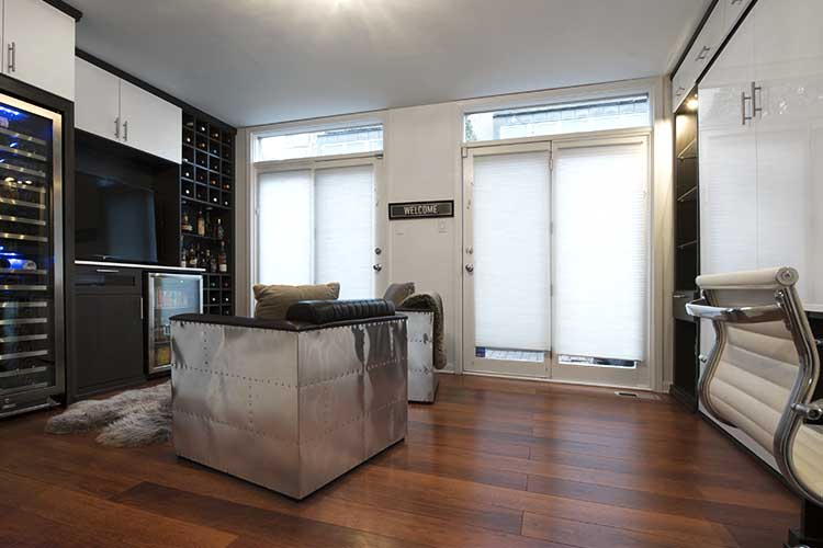 multipurpose room with wine storage, media center, wall bed and desk
