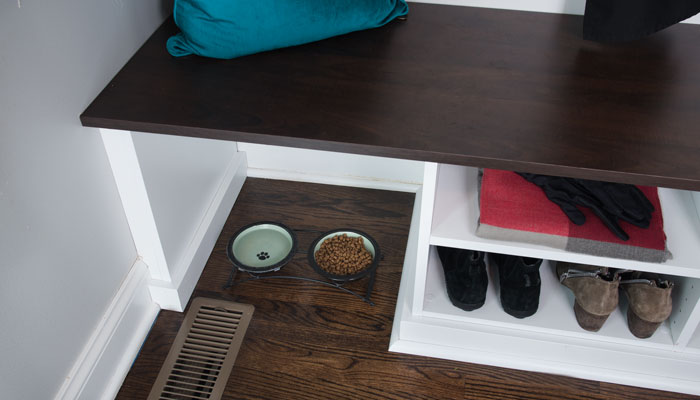 mud room bench with space open over vent