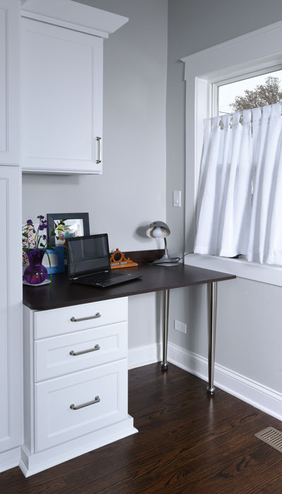 a desk by the back door can help with entryway organization