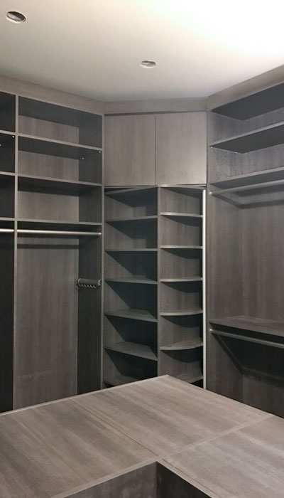 walk-in closet with shoe spinner in Breakwater thermally fused laminate with 360 Organizer