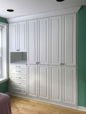 armoire built into preexisting alcove in wall