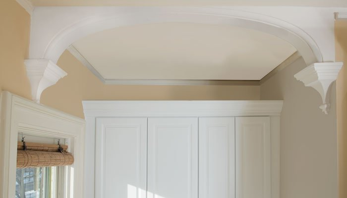 view of arch over standing closet with original corbels