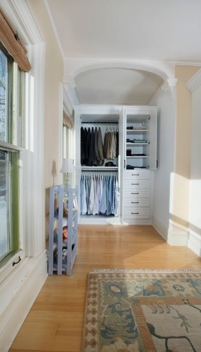 vertical view of custom armoire closets open