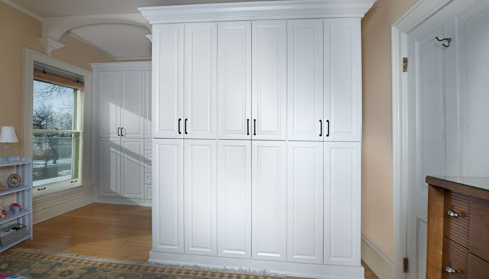 view of armoire closets with doors closed
