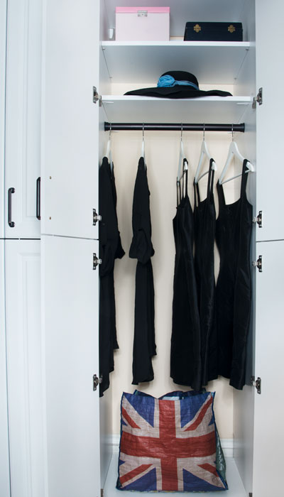 view of her section of the custom standing closet