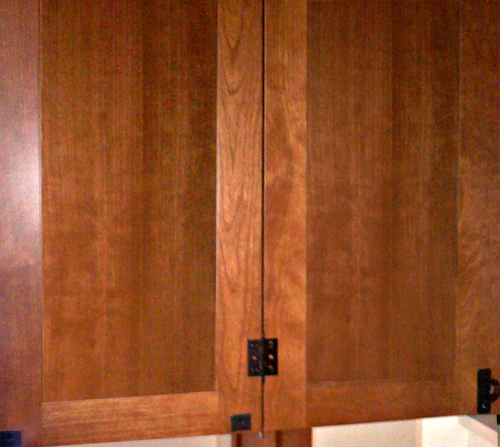 Detail of custom cabinetry bi-fold doors and bi-fold hardware