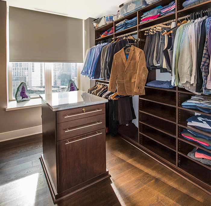 His side of the small walk in closet design