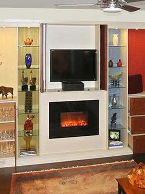 Modern fireplace and fireplace surround with hidden TV cabinet