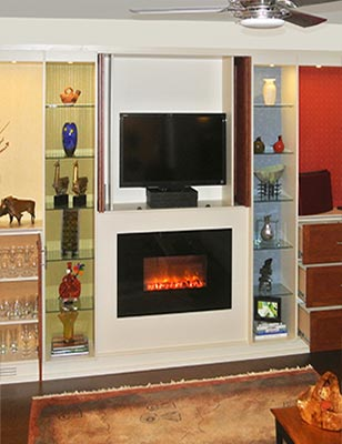 wall unit designed to surround fireplace with media and entertainment storage