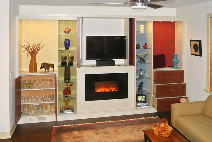 media center - fireplace surround with built-ins for bar and glasses